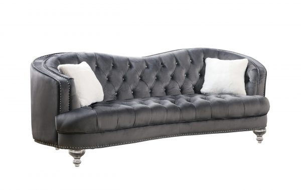 |Upholstered camelback style sofa tufted with faux crystals in velvet fabric with acrylic legs.
